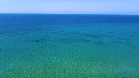 Aerial view of blue tranquil empty sea under the blue sky Live Action