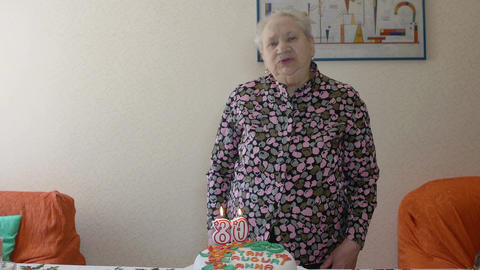 elderly woman and one blows out the candles on her birthday: loneliness, aging Footage