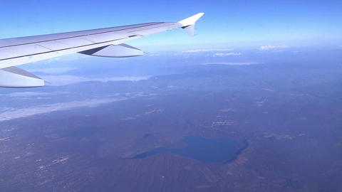Traveling by air. View through an airplane window Footage