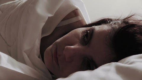 worried and sad woman in bed Footage