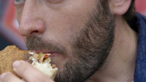 man eating a sandwich in the break time for lunch Footage