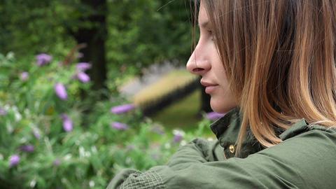 young sad woman closeup portrait Live Action