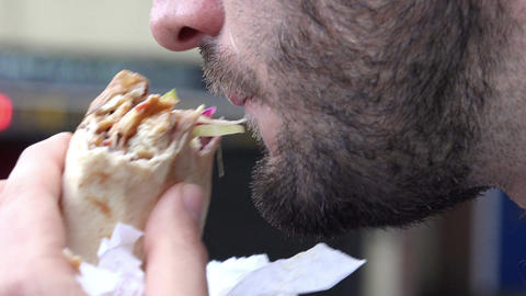 close up footage of a male mouth eating a sandwich Footage