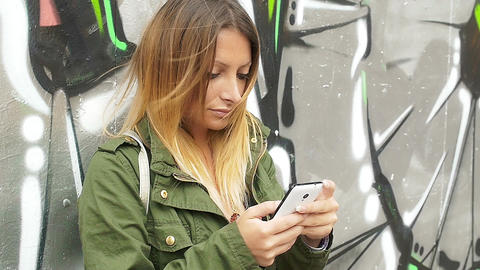 young woman using smartphone in the city Footage
