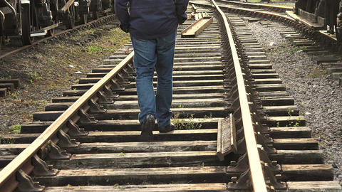loneliness: homeless walking away on the rail tracks Footage