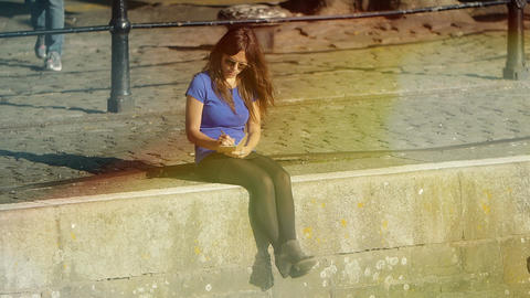 young woman writing her secrets in a diary sitting on the dock of the river Footage