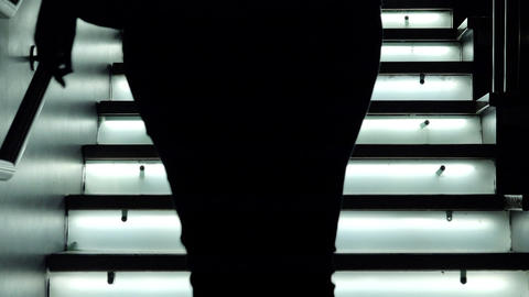 People coming down from a staircase lit: LED lights, glass, modern architecture Footage