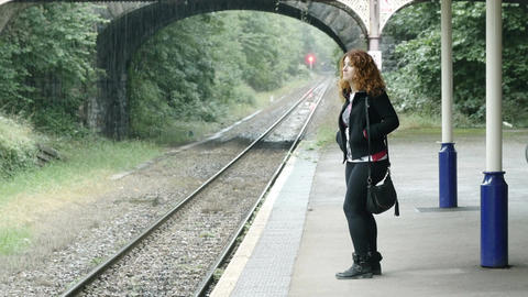 young woman waiting the train on the platform Footage