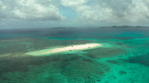 Sandy island with a beach and tourists. Naked Island, Siargao Live Action