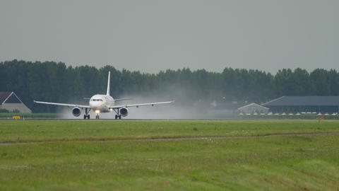 Jet airliner speeding up along the runway to take off Live Action
