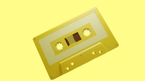 Yellow cassette tape isolated on a yellow background Animation