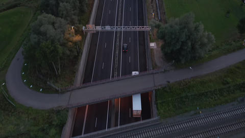 Aerial Birds Eye View of Autobahn freeway at Sunset Live Action