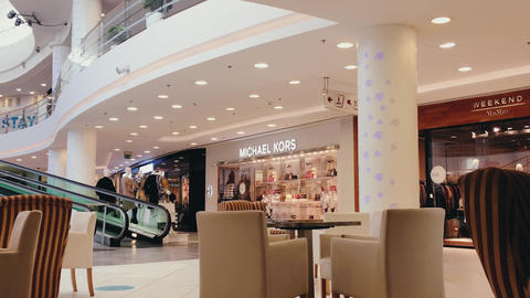 Interior of a restaurant in a modern luxury shopping mall, fashion brands stores Live Action