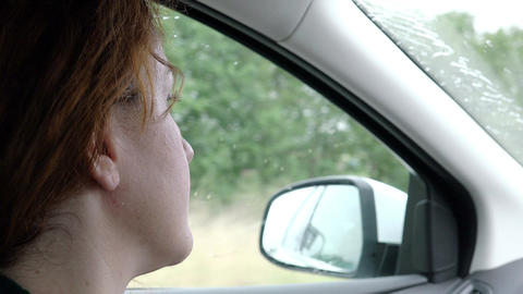 young woman taking off her sunglasses: woman sitting in a car Footage