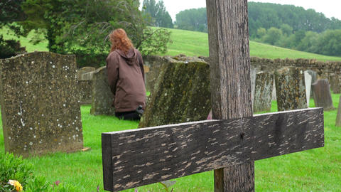 Young woman goes to pray at the tomb of his dear country cemetery, religion Footage