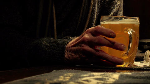 old man's hand taking a pint of beer or cider in a old england pub Live Action