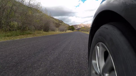 Rural mountain road POV front wheel car HD 955 Footage
