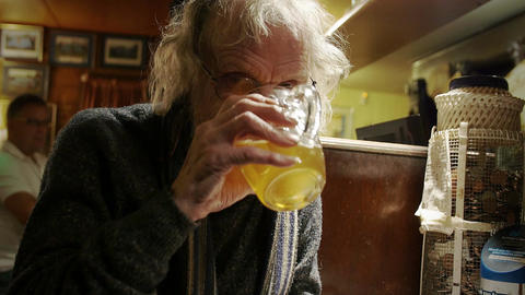 old lonely man drinking beer in an england pub Footage