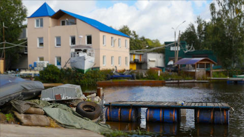House and boats by the river Live Action