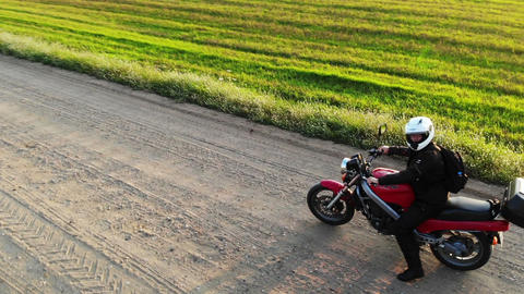 Woman biker riding driving motorcycle by country road, inspirational happy Live Action