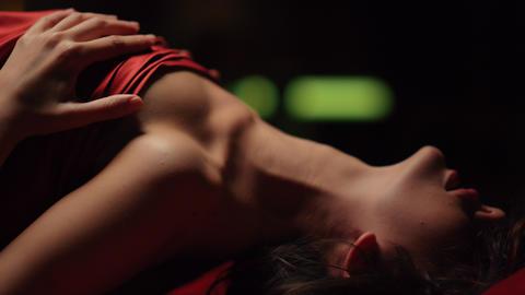 Horny woman fantasizing bed. Beautiful girl caressing breast through silk sheet Live Action
