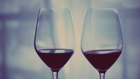 Romantic date night and drink for two, glasses of red wine indoors at wine Live Action