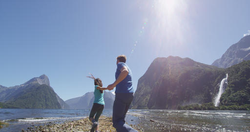 Couple in love having fun outdoors in nature in Milford Sound New Zealand Live Action