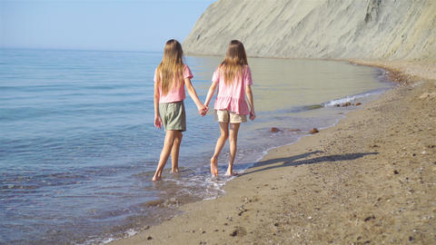 Adorable little girls having fun on the beach Live Action