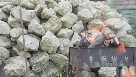 Cooking, oriental cuisine, forest fires, arson concept - lighting fire and coals 실사 촬영