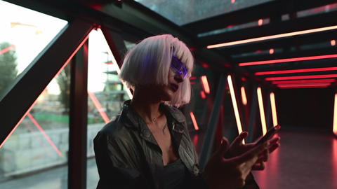 Woman in cyber glasses uses a gadget, phone Live Action