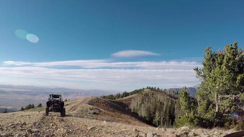 Recreation vehicle off road climb mountain top trail POV…, Live Action