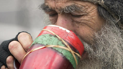 sad old man drinking tea: old man, poor man, homeless, jobless Live Action