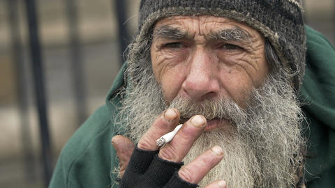 elderly man smoking: homeless ma smoking in the city, poor man smoking Footage