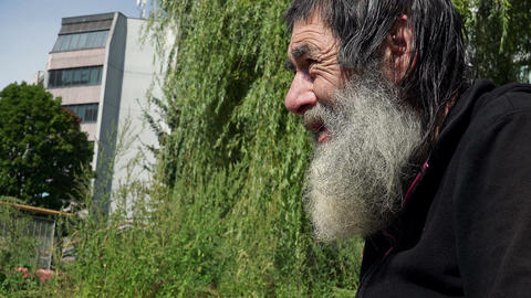 old beggar man in the street: economic crisis, rejected, sadness, loneliness Footage