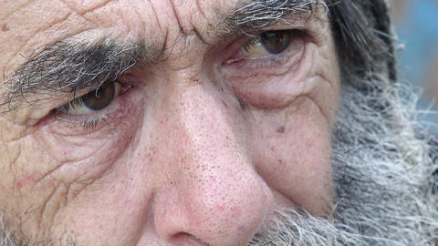 closeup footage on eyes of a real old homeless Footage