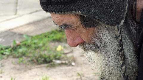 depressed and hopeless old poor man living in the street: homeless Footage
