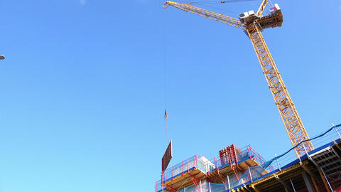 crane working on a construction site in the center of a modern city Footage