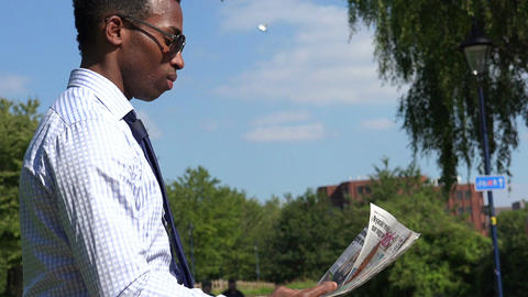 Attractive businessman reading newspaper at lauch break Footage