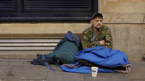 homeless begging in the street: young jobless man Footage