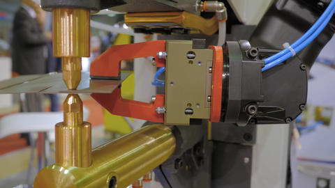 Fully automatic spot welder machine with futuristic robotic clamp arm Live Action
