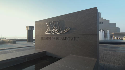 Museum of Islamic Art Doha, Qatar exterior daylight walking in shot Live Action