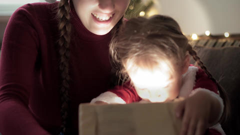 Xmas, winter, new year, Celebration, family concept - Young happy mom with two Acción en vivo