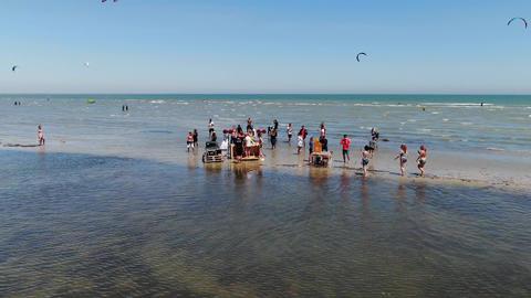 27.07.2020, Genichesk, Ukraine, beach party and kite surfers in the sea, 4k ライブ動画