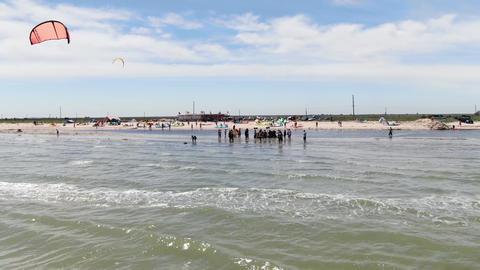 27.07.2020, Genichesk, Ukraine, people in shallow water watching kite surfers 4k ライブ動画