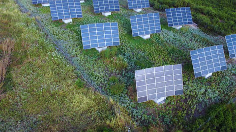 Solar power station with solar panels on the field for producing renewable energy and energy saving Live Action
