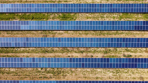 Flight over the solar power station. Solar panels for power production on the field Live Action