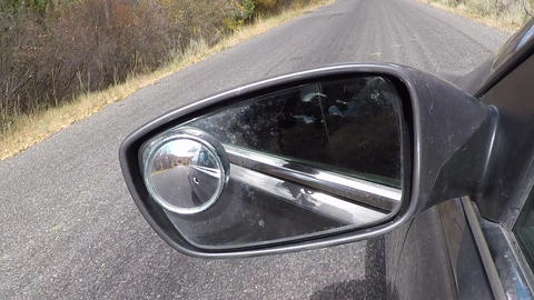 Dirty mirror side of car POV mountain road HD 958 Stock Video Footage