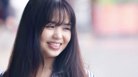 smiling young adult chinese woman: portrait of beautiful and happy asian woman Live Action