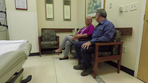 Doctor exam room husband and wife HD 890 Footage