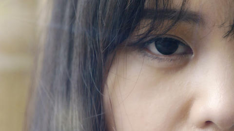 close up portrait on chinese young woman's eye Footage